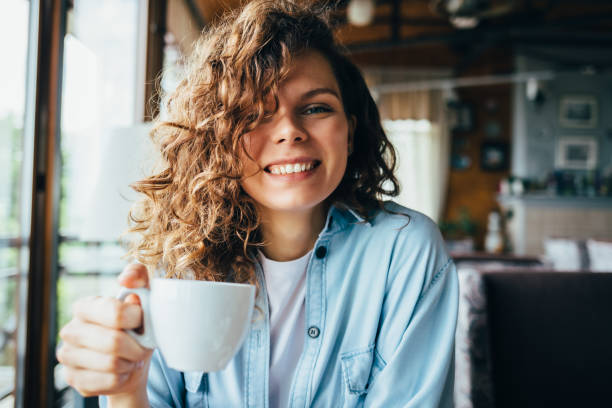 Happy young woman with curly hair stock photo