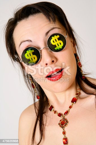 A DSLR photo of a happy young woman with dollar signs at her glasses. The woman is wearing a beautiful necklace. Can illustrate the concept of wealth, shopping, greed, profit, investment, gambling, etc.