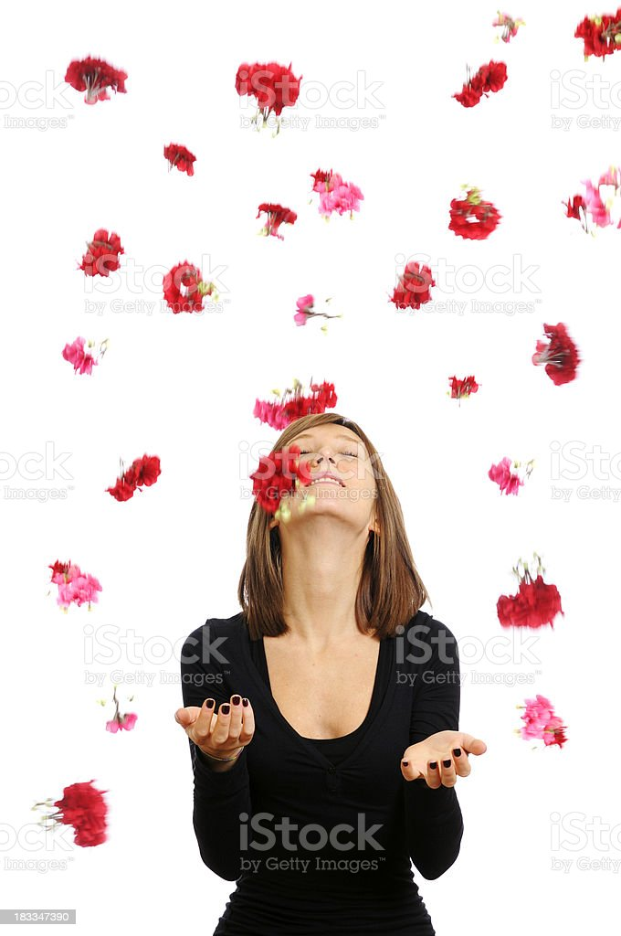 Happy Young Woman with Falling Flowers royalty-free stock photo