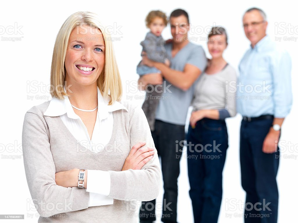 Happy young woman with family standing in background royalty-free stock photo