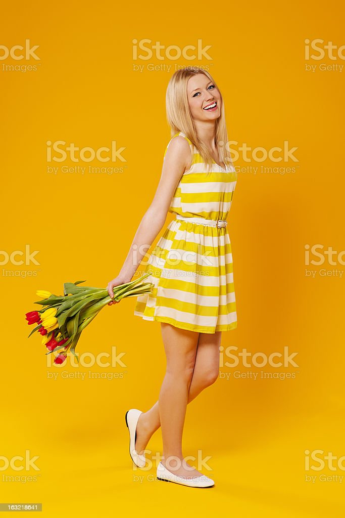 Happy young woman with flowers royalty-free stock photo