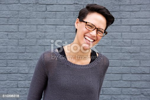 istock Happy young woman with glasses 510398318
