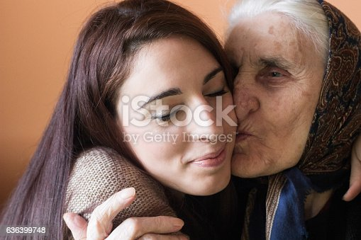 144362548istockphoto Happy young woman with grandmother 636399748