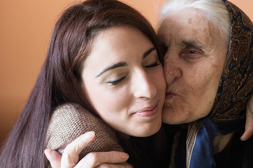 144362548 istock photo Happy young woman with grandmother 636399748