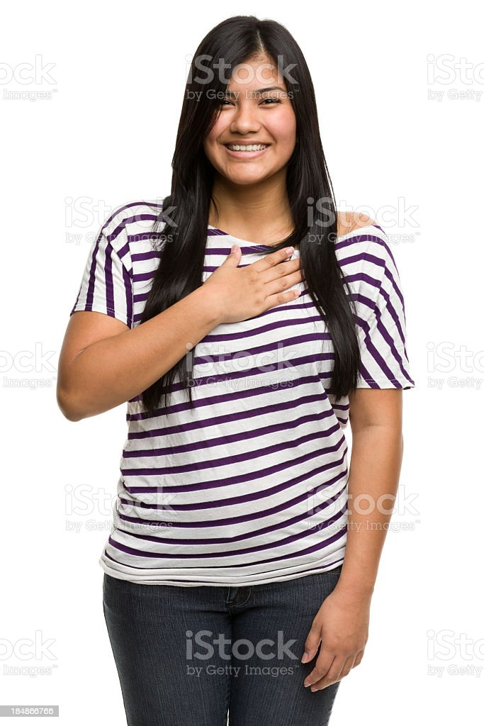 Happy Young Woman With Hand On Heart royalty-free stock photo