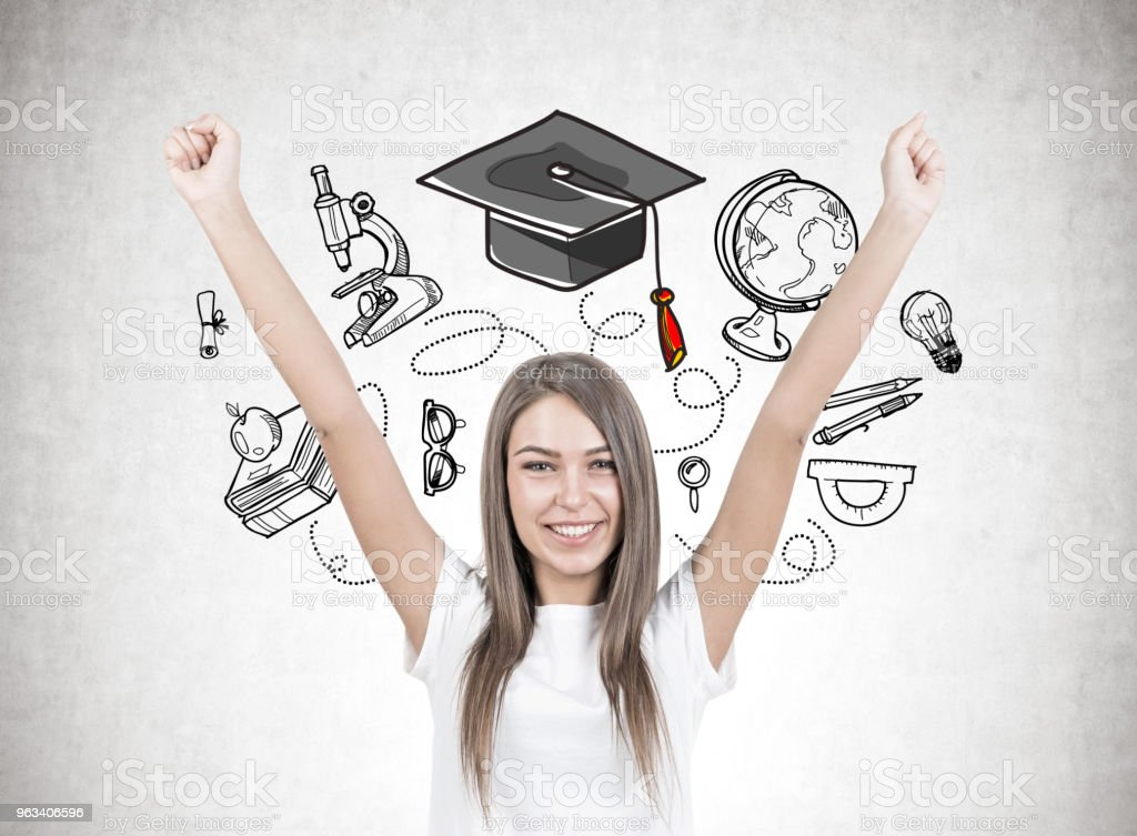 Happy young woman with hands in the air, education - Zbiór zdjęć royalty-free (Biały)