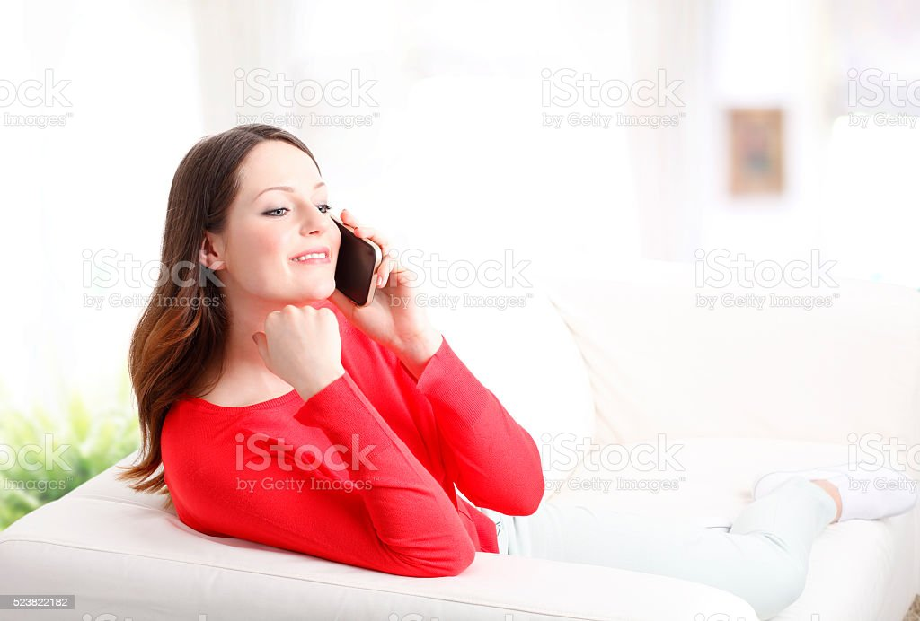 Happy young woman with handy stock photo