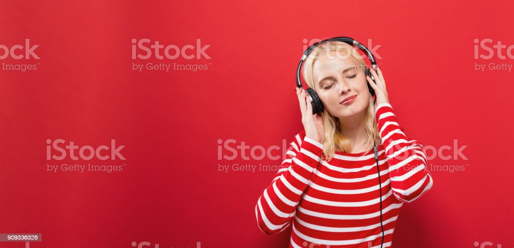 Happy young woman with headphones stock photo
