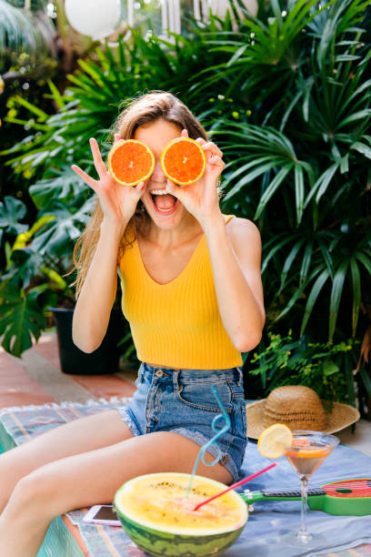 glückliche junge frau mit orangen - rawpixel woman stock-fotos und bilder