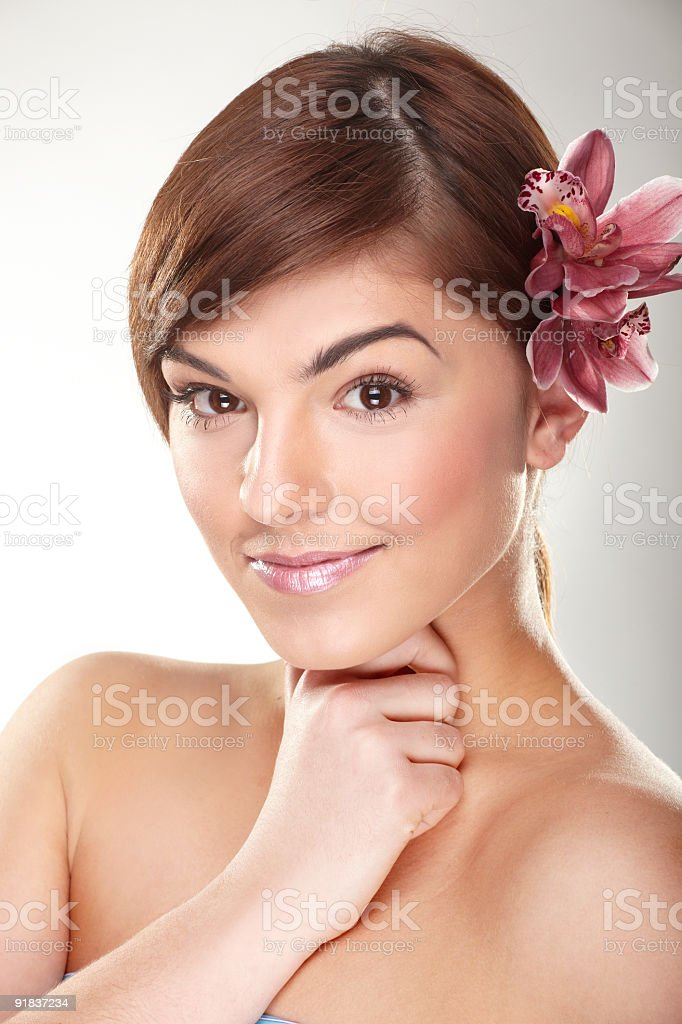 happy young woman with orchid royalty-free stock photo