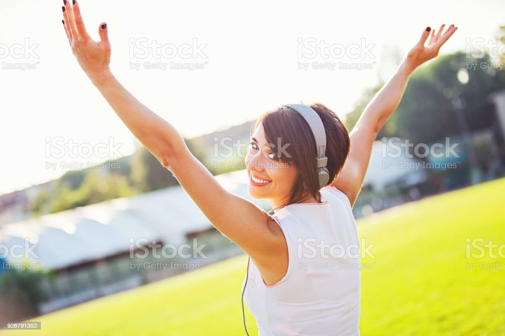 happy young woman with outstretched arms stock photo more pictures