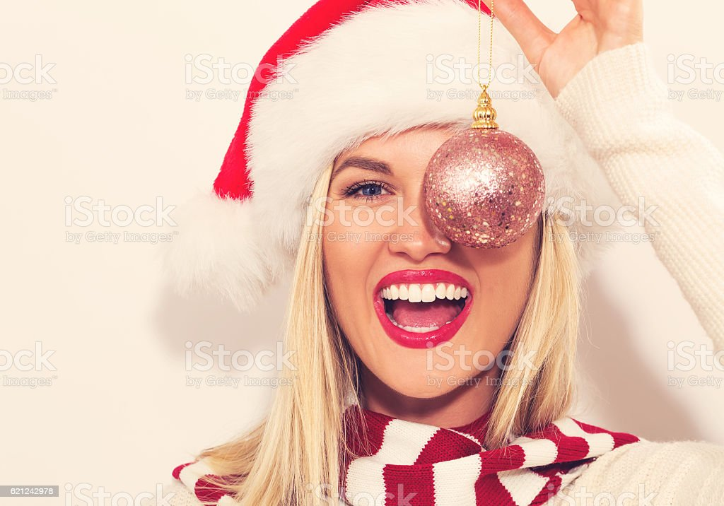 Happy young woman with Santa hat stock photo