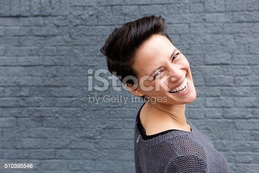 istock Happy young woman with short hair 510395546