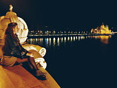 Happy young woman wondering in Budapest night panorama, Hungary