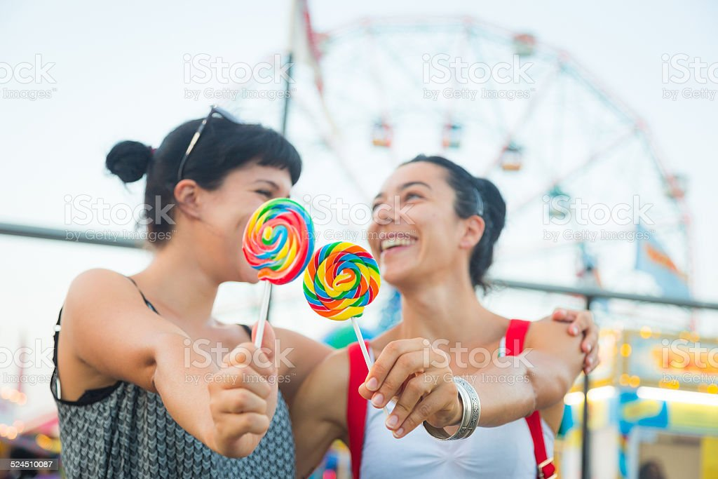 Happy Young Women eating Lollipop - Royalty-free Adult Stock Photo