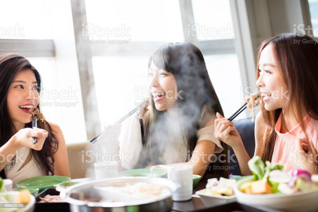 happy young Women group  Eating hot pot zbiór zdjęć royalty-free