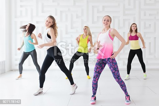 Happy young women having a calorie-burning dance fitness class