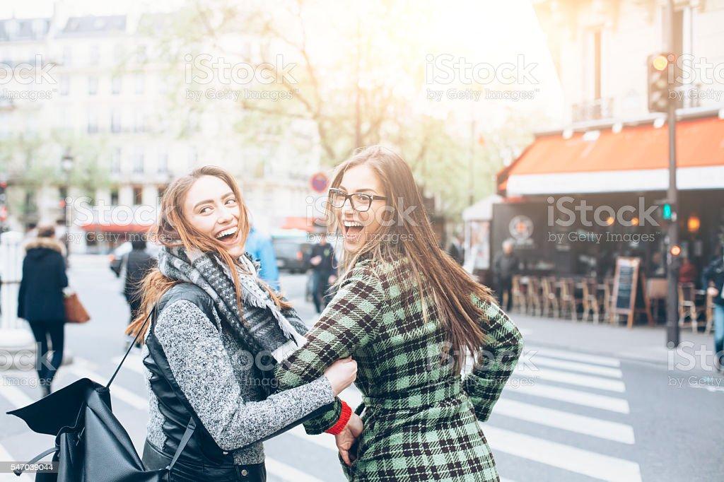 Happy young women having fun on street stock photo
