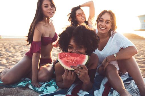 Happy young women having fun on the beach