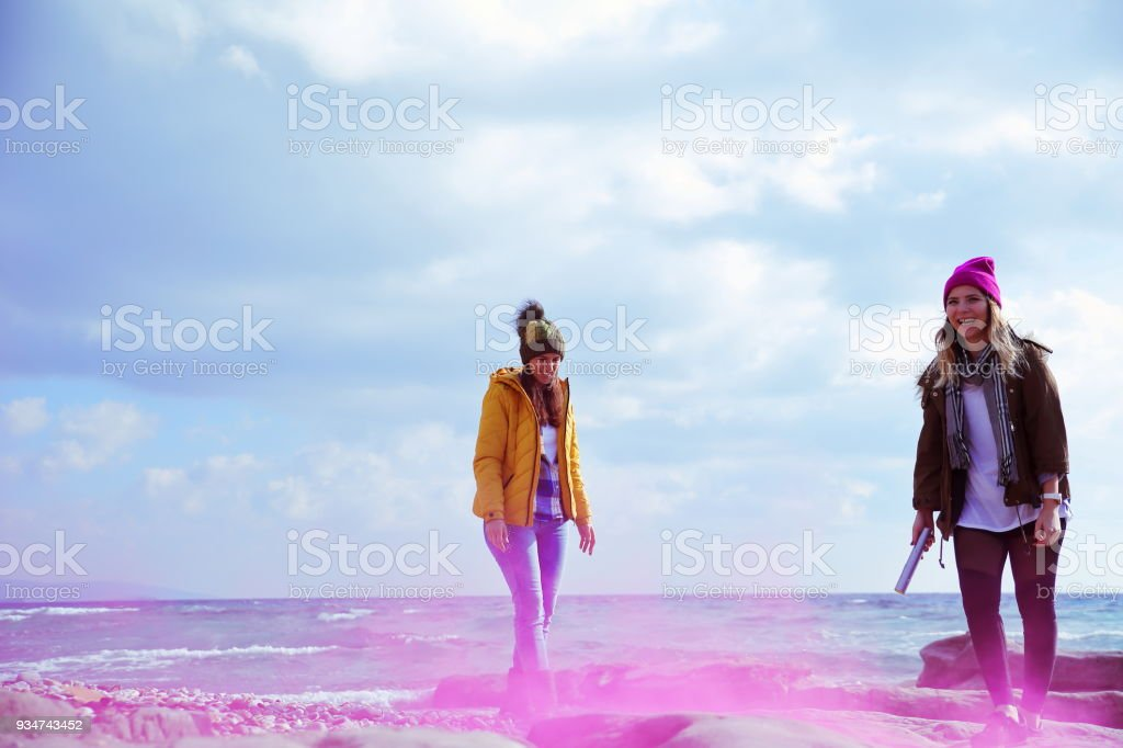 Happy Young Women Having Fun With smoke bomb stock photo