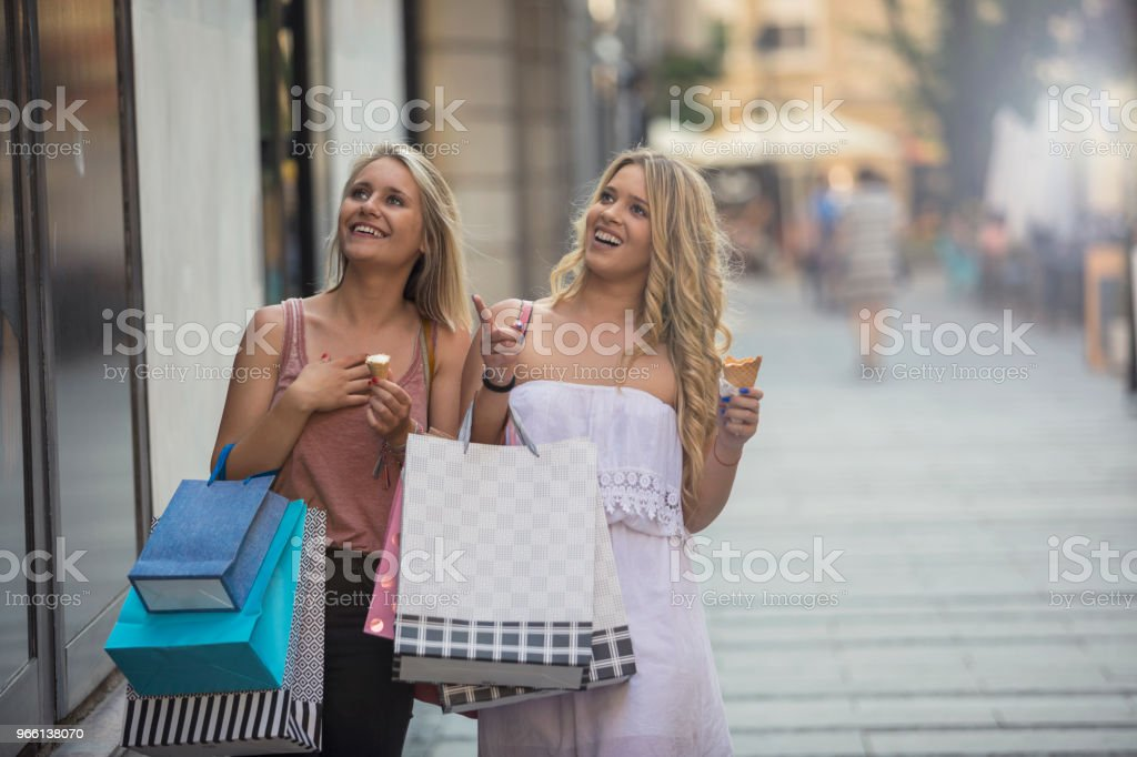 Happy young women in shopping - Royalty-free Adult Stock Photo