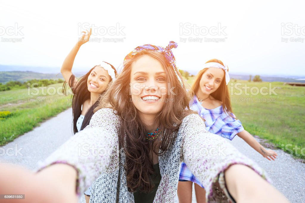Happy young women making selfie on country road stock photo