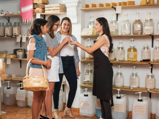 Happy young women shopping in zero waste store stock photo
