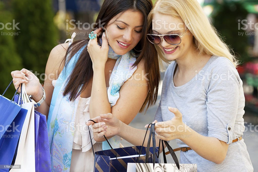 happy young women shopping royalty-free stock photo