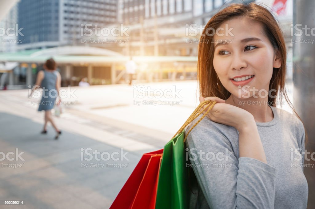 Happy young women with shopping bags in the city zbiór zdjęć royalty-free
