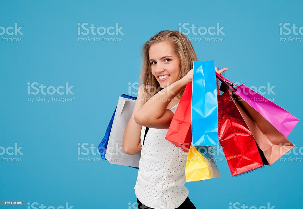 Happy young women with shopping bags royalty-free stock photo
