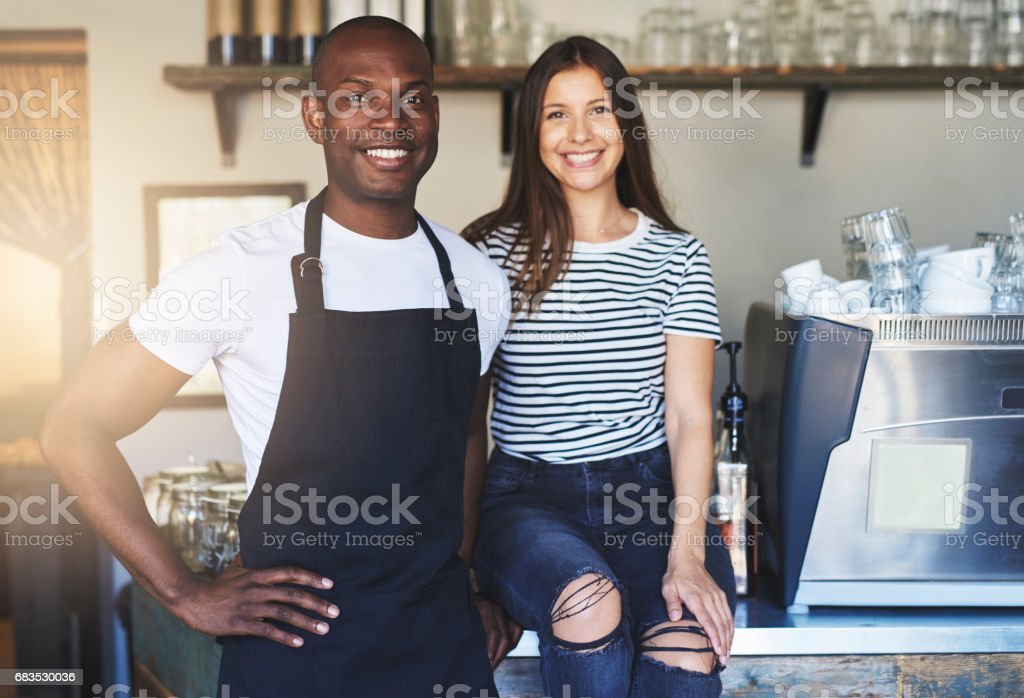Happy young workers in restaurant stock photo