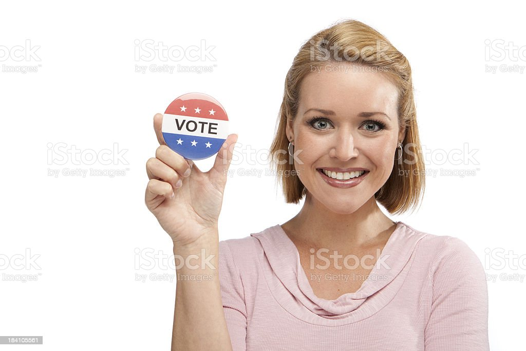 Happy Youthful Girl Holding A Vote Button royalty-free stock photo