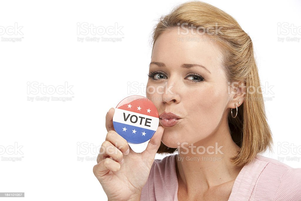 Happy Youthful Girl Kissing A Vote Button royalty-free stock photo