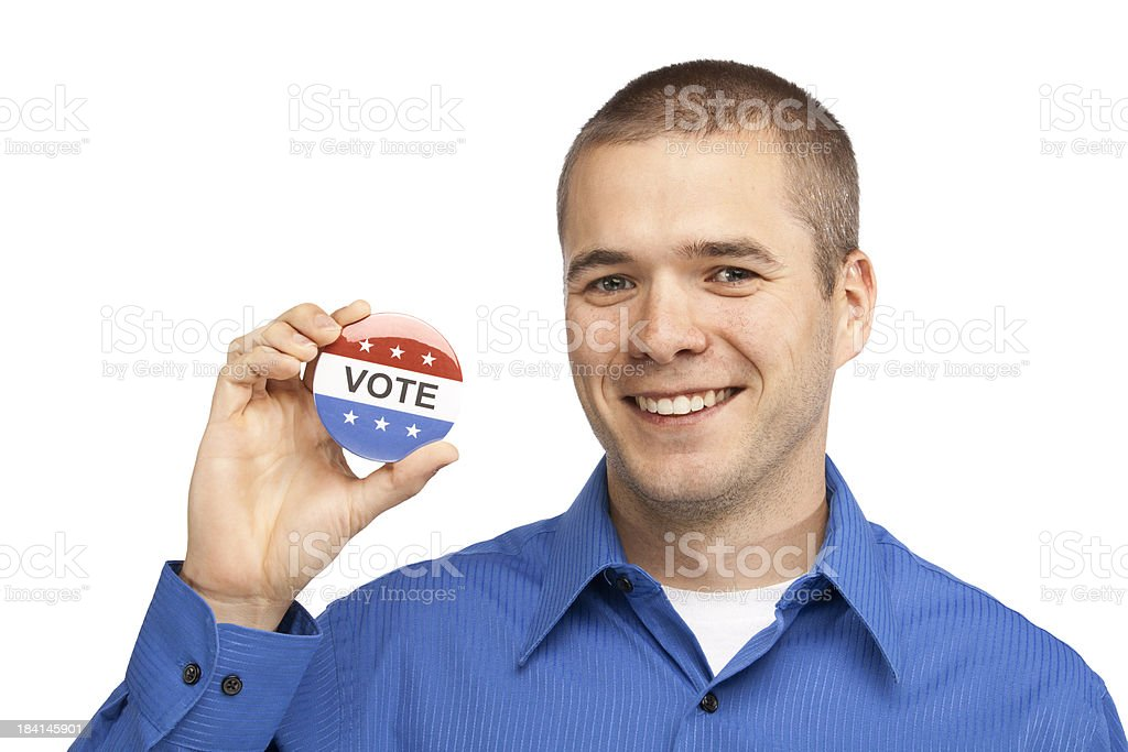 Happy Youthful Male Holding A Vote Button stock photo