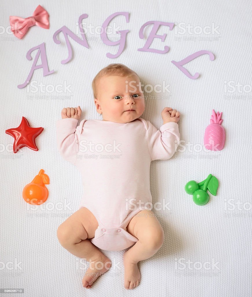 Happy-looking baby posing for camera royalty-free stock photo