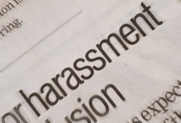 Harassment headline in newspaper Harassment headline in newspaper prettige verrassingen stock pictures, royalty-free photos & images