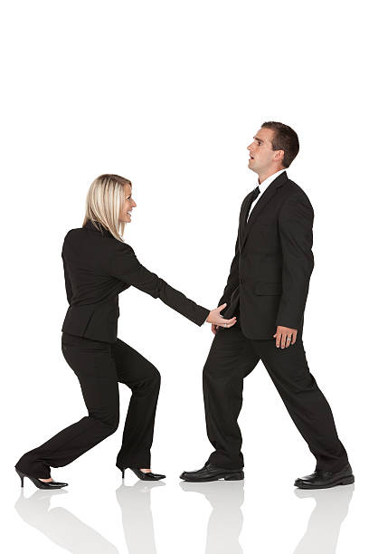harassment in the office - man dominating woman stock photos and pictures