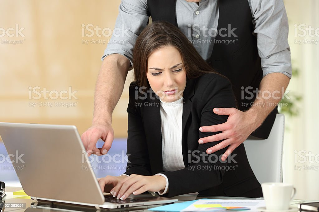 Harassment with a boss touching to his secretary - foto stock
