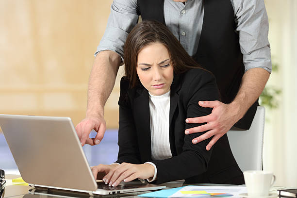 Harassment with a boss touching to his secretary - foto de stock