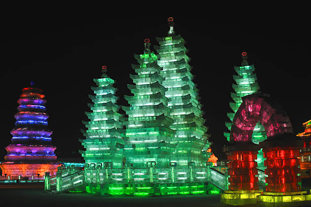 Harbin Ice Festival, Buddhist pagodas Illuminated pagodas at night, Harbin Ice Festival harbin stock pictures, royalty-free photos & images