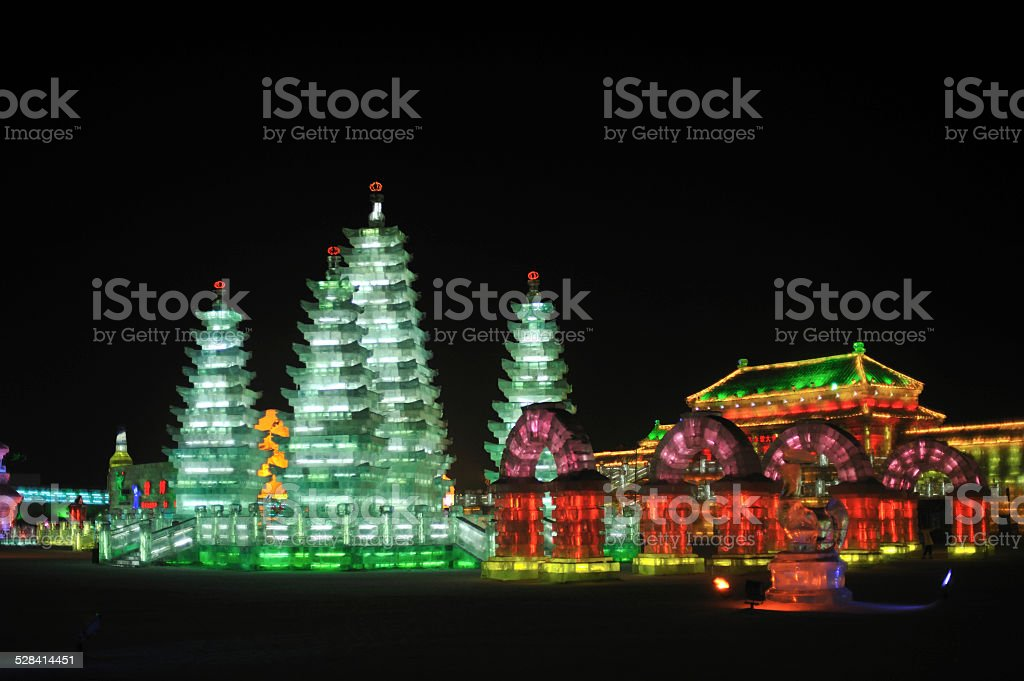 Harbin Ice Festival, Pagodas and Forbidden City Illuminated pagodas, arches and pavilion of the Forbidden City at night, Harbin Ice Festival Arch - Architectural Feature Stock Photo