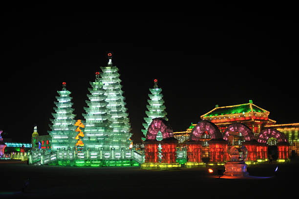 Harbin Ice Festival, Pagodas and Forbidden City Illuminated pagodas, arches and pavilion of the Forbidden City at night, Harbin Ice Festival harbin ice festival stock pictures, royalty-free photos & images