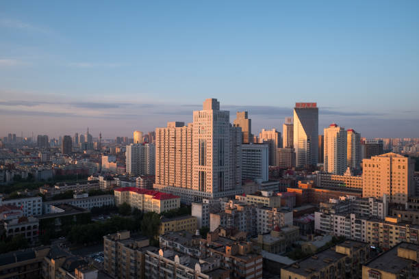 Harbin in dawn, China Harbin, China. June 6, 2018: Aerial view of Harbin city at sunrise. harbin stock pictures, royalty-free photos & images