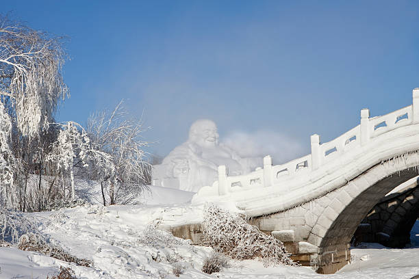 Harbin Buddha ice sculpture at Ice Festival in Harbin, China harbin stock pictures, royalty-free photos & images