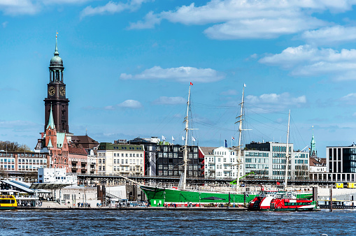 harbor and waterfront in Hamburg, Germany, against blue sky