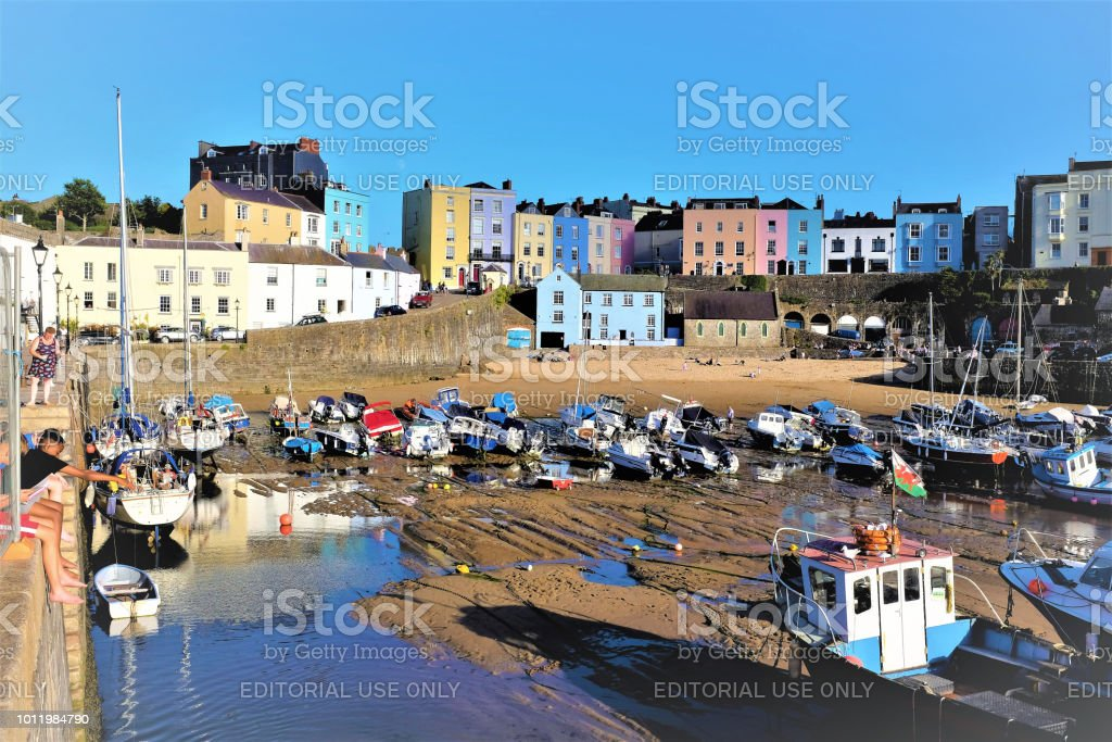 Harbor at low tide, Tenby, South Wales, UK. stock photo