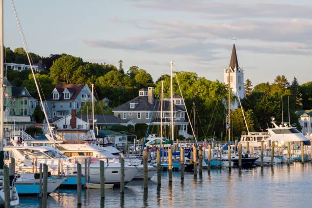 harbor at mackinac island, michigan at sunset. - mackinac island stock photos and pictures