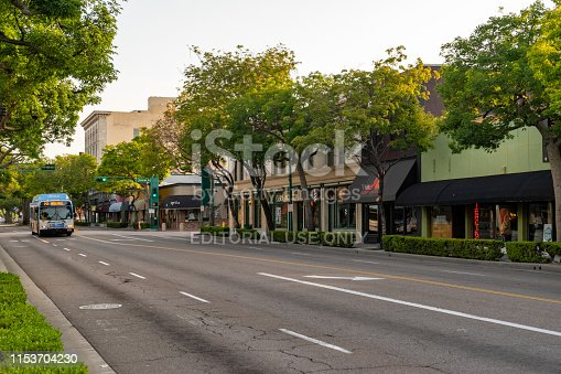 Fullerton, CA / USA – May 25, 2019: Early morning a Orange County bus travels south on Harbor Boulevard in the City of Fullerton, California.