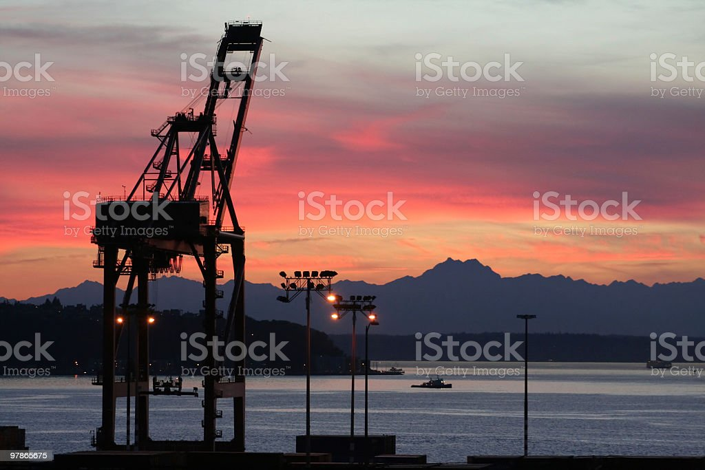 harbor crane at sunset stock photo