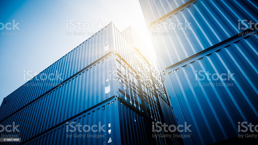 harbor freight containers in the sun,blue toned images. Blue Stock Photo